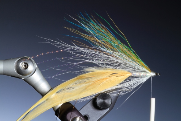 8. Tie in another smaller bunch of white buck tail for the throat of the fly.